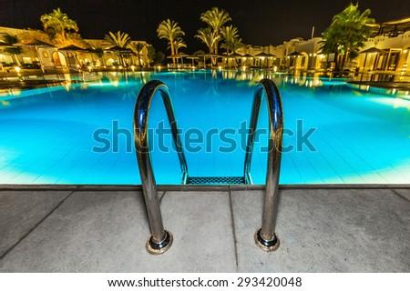 Vecherniy pool and lighting - stock photo