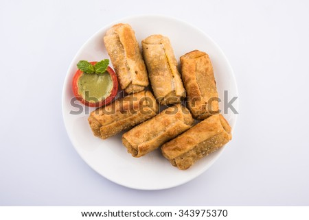 veg roll in white dish with mint leaf, isolated on white background, top view