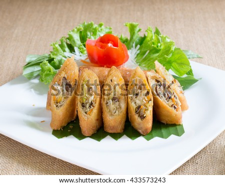 Veg. Spring Rolls with sweet sauce, on white dish and brown cloth / Selective focus