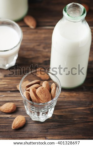 Vegan Almond milk on the vintage table, selective focus