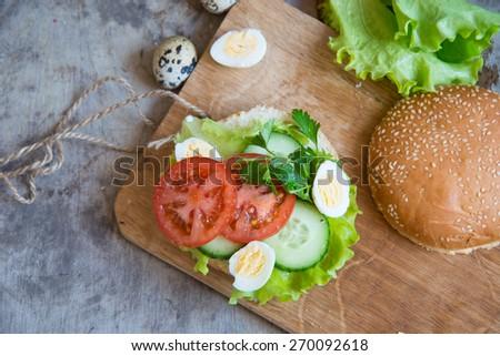 Vegan  burger with fresh vegetables - stock photo