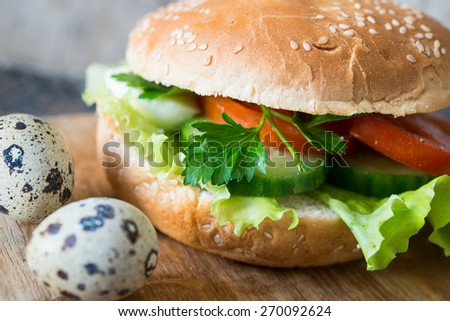Vegan  burger with fresh vegetables/selective focus - stock photo
