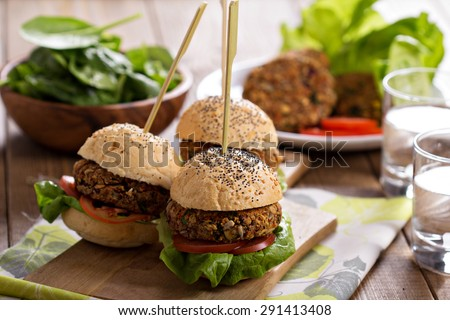 Vegan burgers with  beans and vegetables served in a poppy seed bun - stock photo