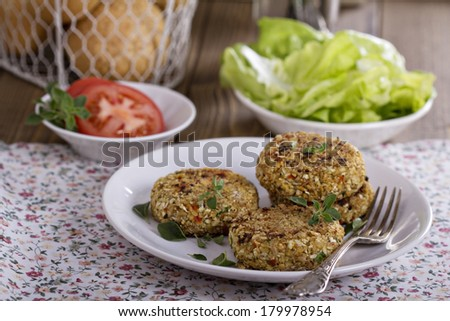 Vegan burgers with cauliflower and red pepper - stock photo