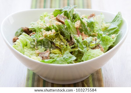Vegan Caesar salad made with crisp romaine lettuce tossed with Caesar dressing and topped with Pine Nut Parmesan