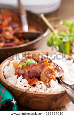 Vegan chili with beans, mushrooms, and vegetables served on rice - stock photo