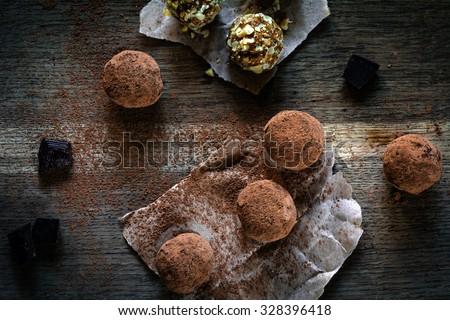 Vegan chocolate truffles on textured wooden background - stock photo