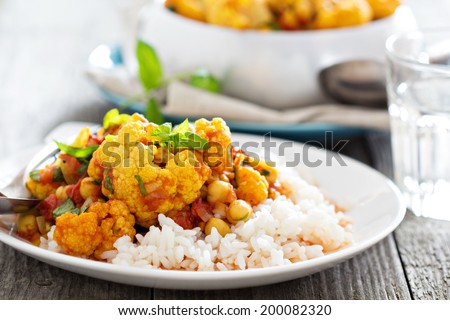 Vegan curry with chickpeas, tomatoes and cauliflower - stock photo