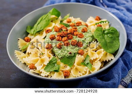 Vegan Farfalle pasta with spinach  sauce with fried chickpeas. Proper nutrition. Sports nutrition. Dietary menu.