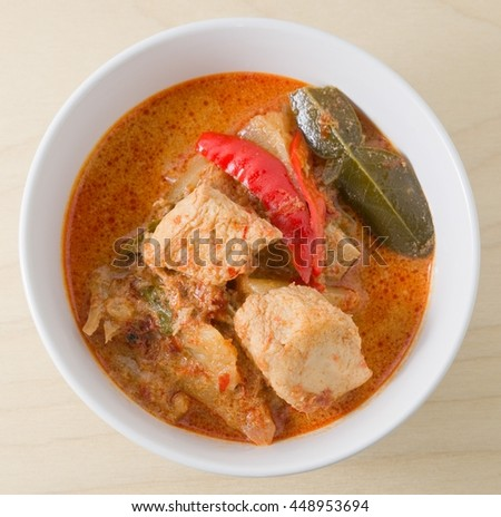 Vegan Food, Top View of Delicious A Plate of Thai Spicy Red Curry with Textured Vegetable Protein, Pineapple and Coconut Milk. - stock photo