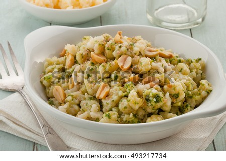 Vegan gnocchi casserole on wooden background