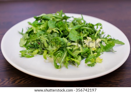 Vegan Green Salad Fresh Raw Healthy Dinner With Lettuce And Arugula Served On A Plate