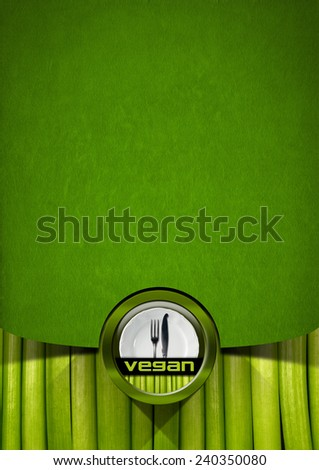 Vegan Menu Design. Vertical vegan menu with empty white plate and silver cutlery, fork and knife, on green velvet background and vegetables - stock photo