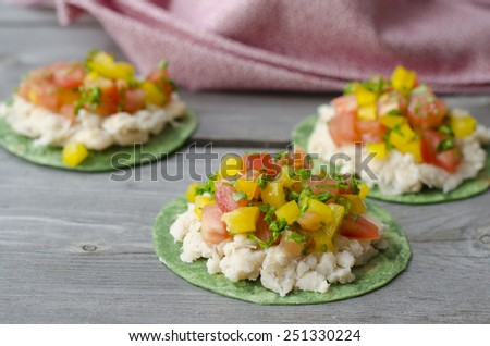 Vegan Mexican Pizzettes. tortillas with mashed white beans, tomatoes and bell peppers - stock photo