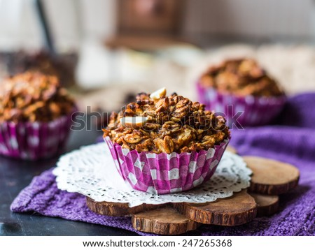 vegan oat muffins with dried fruits and nuts, healthy food - stock photo