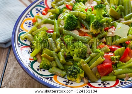 vegan plate with pepper onion green beans and other healthy vegetables - stock photo