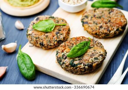 vegan quinoa eggplant spinach chickpeas Burger. toning. selective focus - stock photo