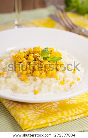 Vegan risotto with baked corn served on a plate - stock photo