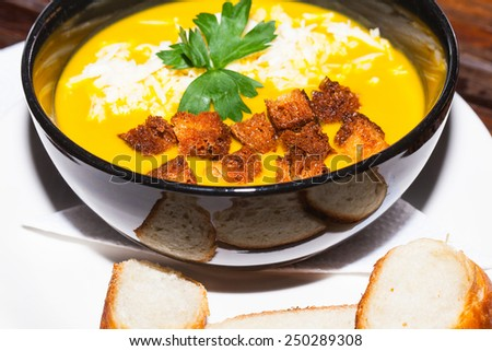 Vegan soup with parsley and crouton - stock photo