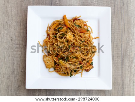 Vegan spaghetti with tofu and pepper delicious from above on wood desk - stock photo