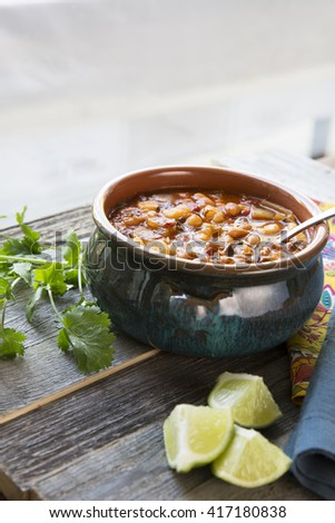 Vegan style mexican posole with hominy and pento beans. - stock photo