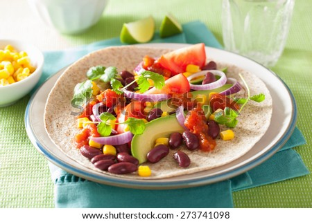 vegan taco with vegetable, kidney beans and salsa - stock photo