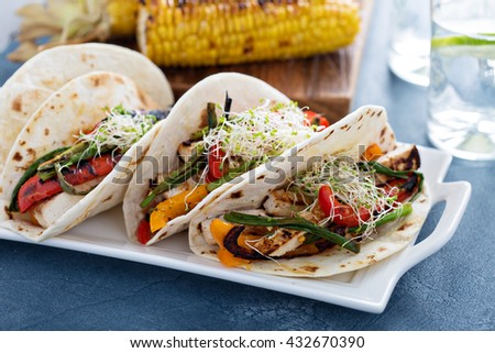 Vegan tacos with grilled tofu, herbs and vegetables - stock photo