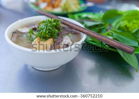 Vegan version of Pho famous vietnamse noodle soup, served with fresh herbs at the buddhist eatery, Nha Trang, Vietnam. - stock photo