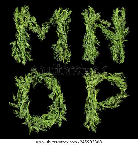 Vegetable Alphabet of sprigs of dill isolated on a black background. Letters M, N, O , P - stock photo