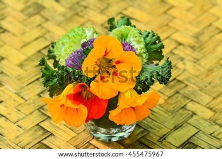Vegetable and flower design on table for event.
