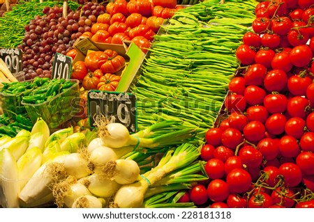 Vegetable and fruit stall in Mercat de la Boqueria at Barcelona - stock photo