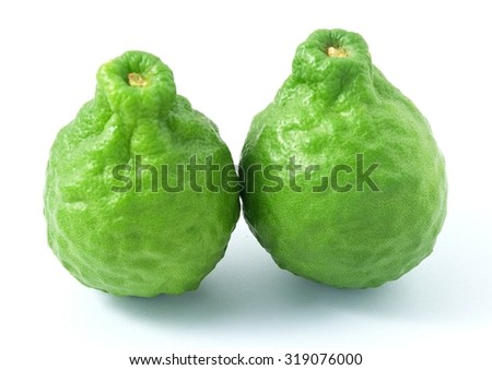 Vegetable and Herb, Two Fresh Kaffir Lime for Seasoning in Cooking Isolated on A White Background. - stock photo