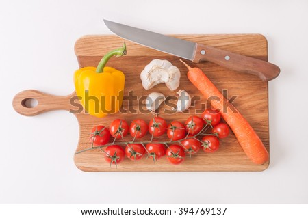 Vegetable and knife on trencher