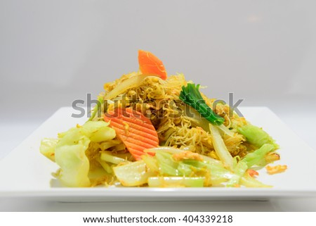 Vegetable and meat asian noodles on a plate