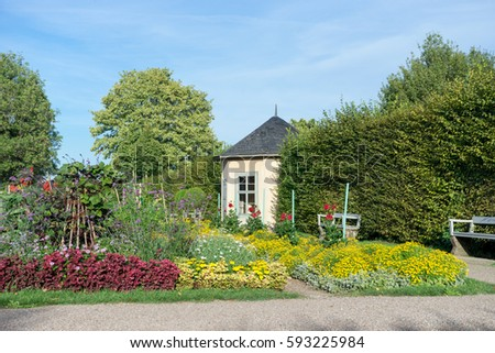 Vegetable and ornamental garden with garden houses / vegetable and ornamental garden / garden