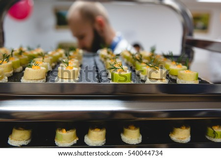 Vegetable appetizers stand on black trays