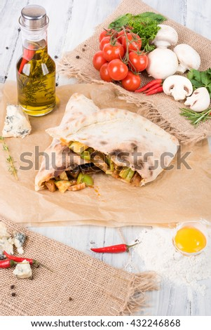vegetable calzone , closed pizza , Italian pastries stuffed with cheese and vegetables