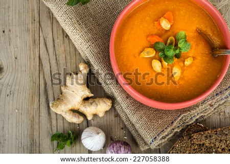 Vegetable Cream Soup in the Bowl with seeds and rustic Bread - stock photo