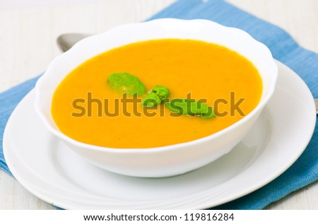 vegetable cream soup in white bowl - stock photo