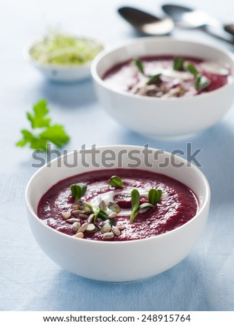 Vegetable cream soup with seeds, selective focus - stock photo