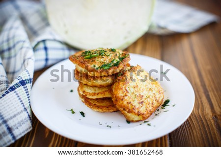 Vegetable fritters with cabbage and dill  - stock photo