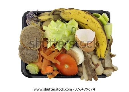 Vegetable, fruit household kitchen food waste, collected in re-used packaging, for home composting. - stock photo