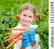 Vegetable garden - lovely gardener with bunch of carrots - stock photo