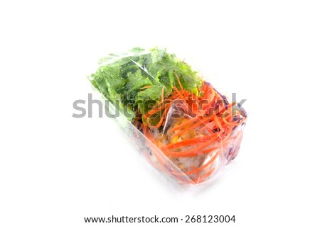 vegetable in plastic bags on white - stock photo