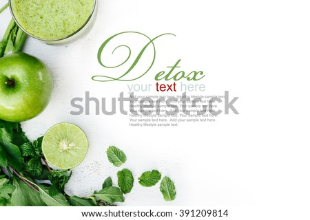 Vegetable juice, apple, sliced lime, leaves of mint and celery on the white wooden background. Detox - stock photo