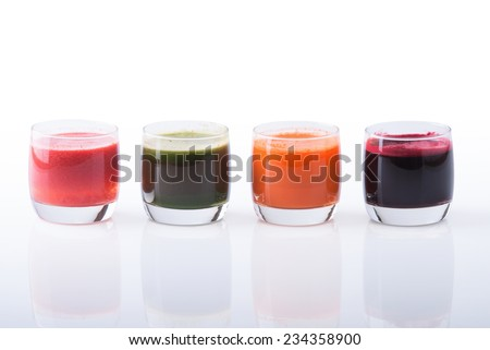 Vegetable juice (carrot, beet, cucumber, tomato). Isolated on white background with clipping path included - stock photo