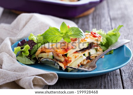 Vegetable lasagna with zucchini, tomato and eggplant - stock photo