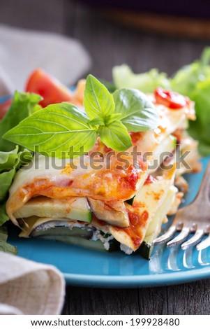 Vegetable lasagna with zucchini, tomato and eggplant - stock photo