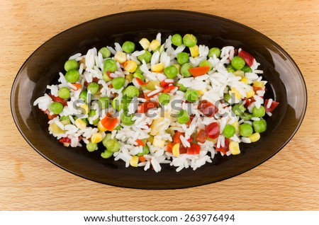 Vegetable mixture in dish on wooden table. Top view