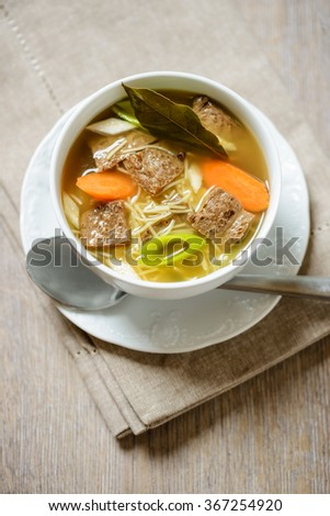vegetable noodle soup with soy meat - stock photo